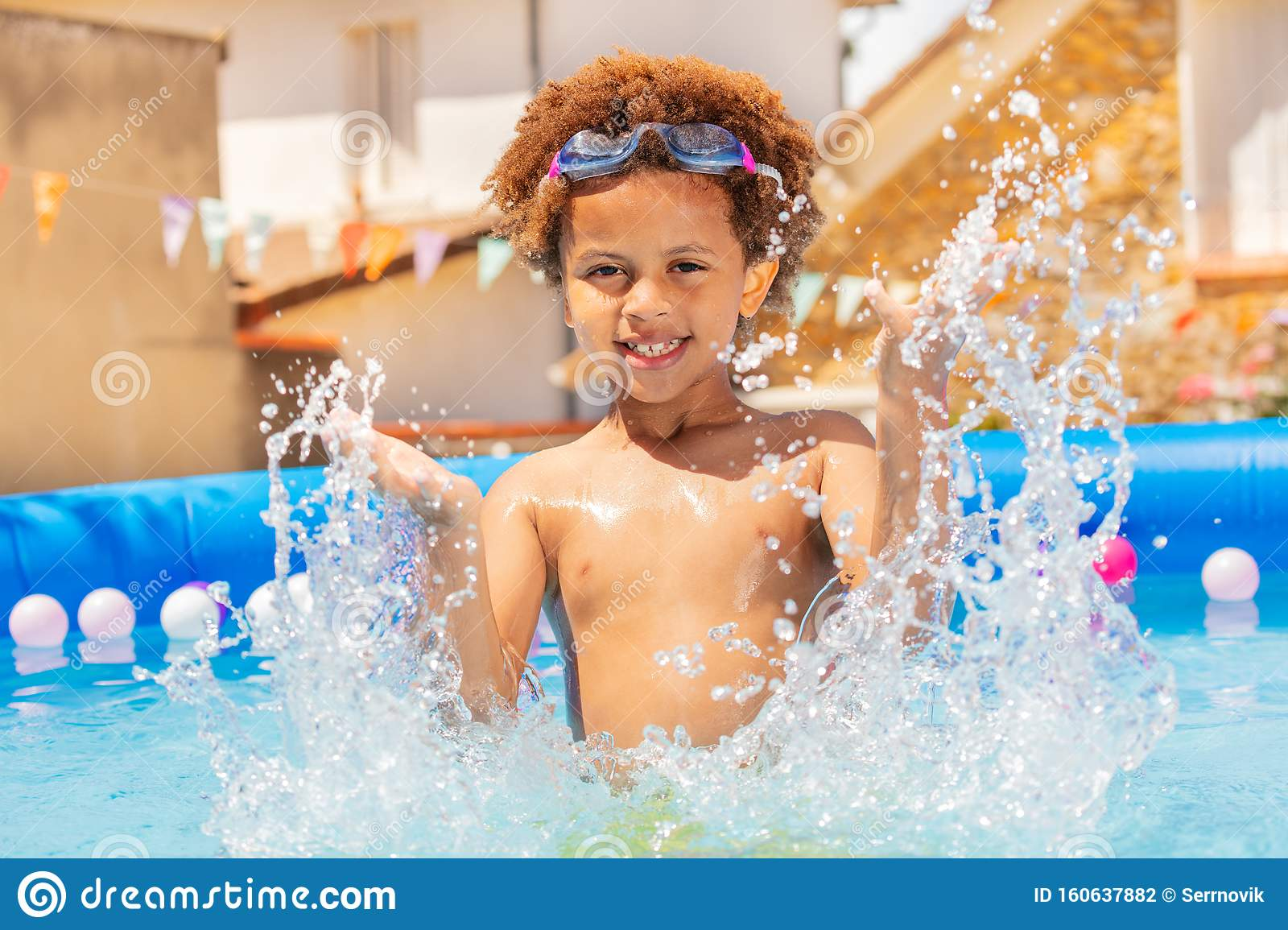 Cute Curly Boy Splash Water In Small Swimming Pool Stock Photo Image Of Childhood Smiling 160637882