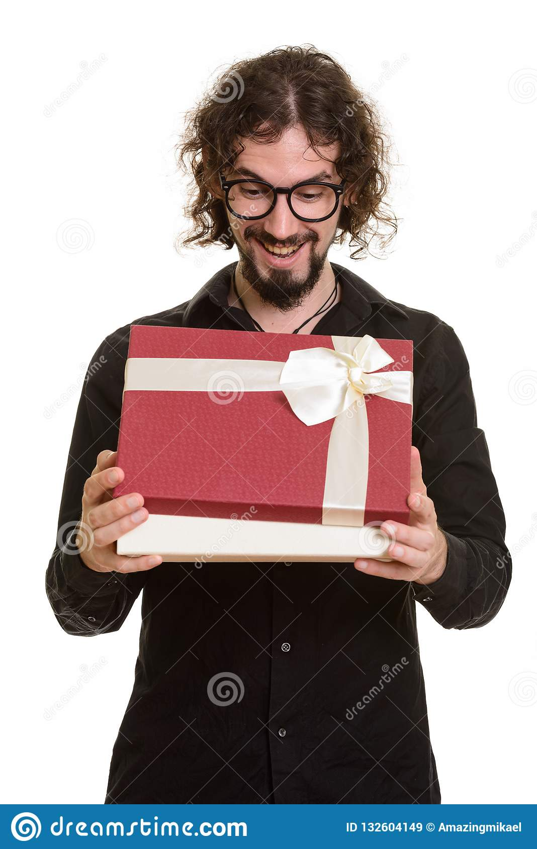 Happy handsome Caucasian man opening gift box ready for Valentin