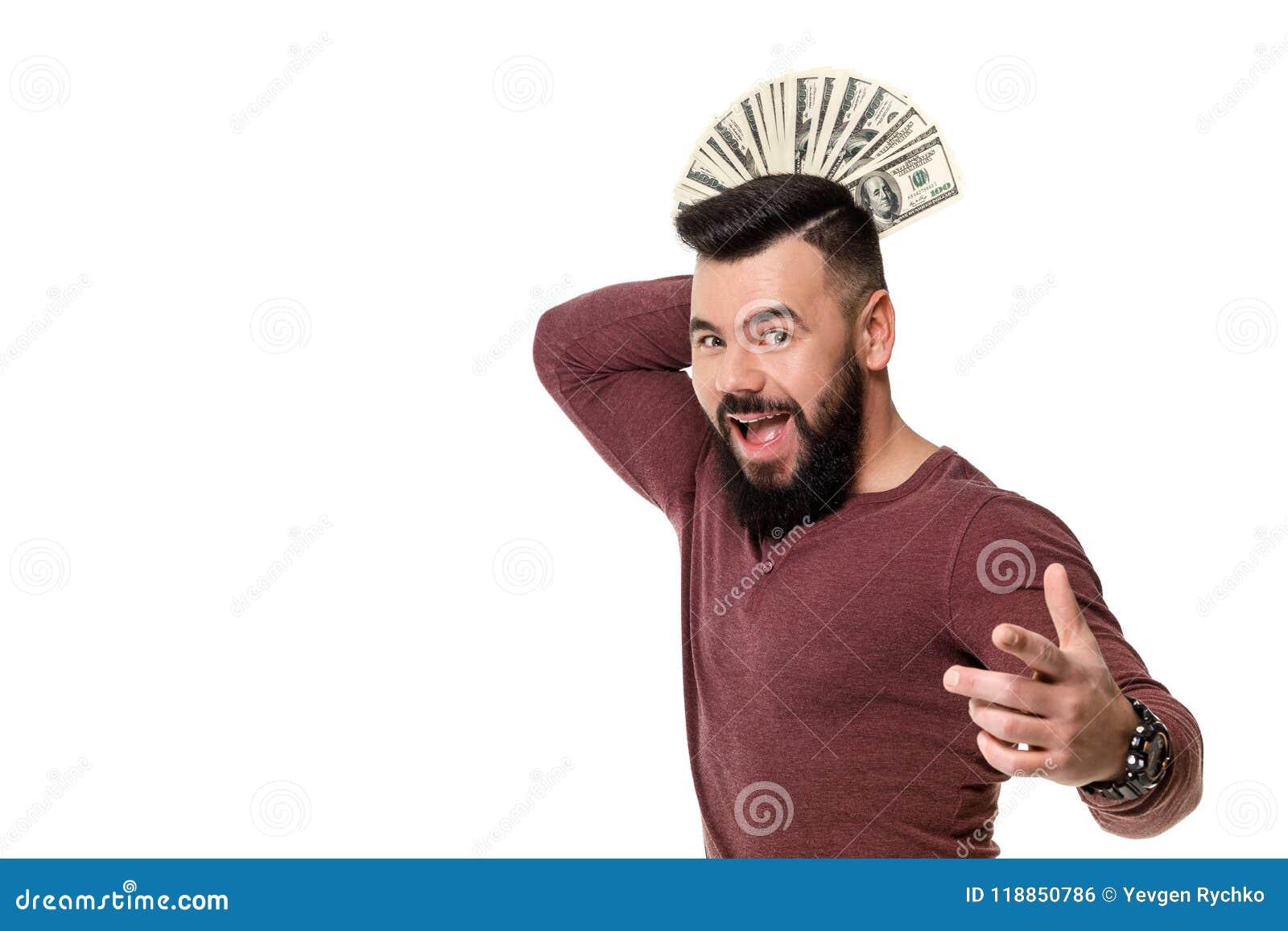 Man with beard holding money