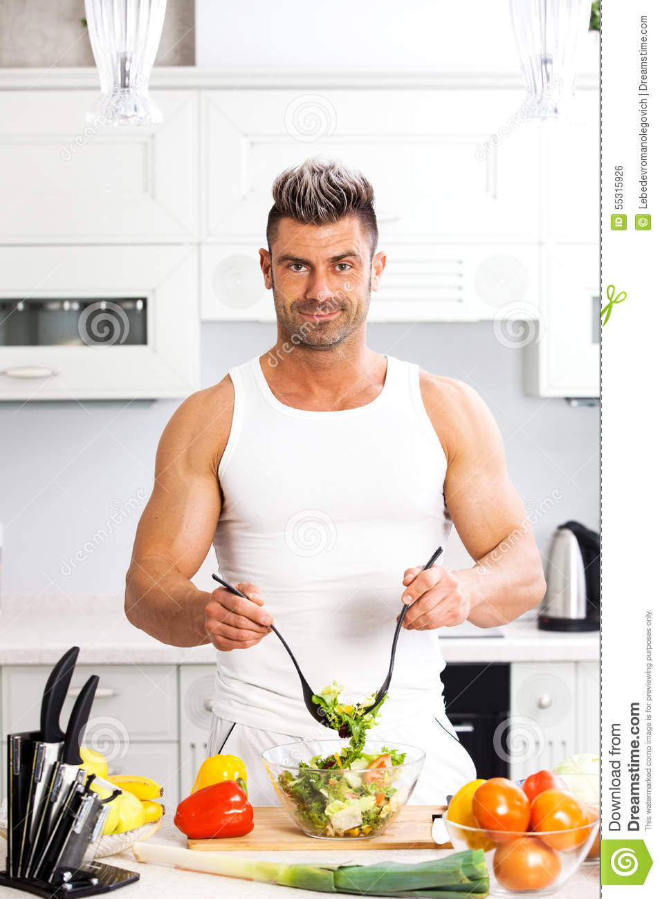 Happy Handsome Man Cooking In Kitchen At Home. Stock Photo ...