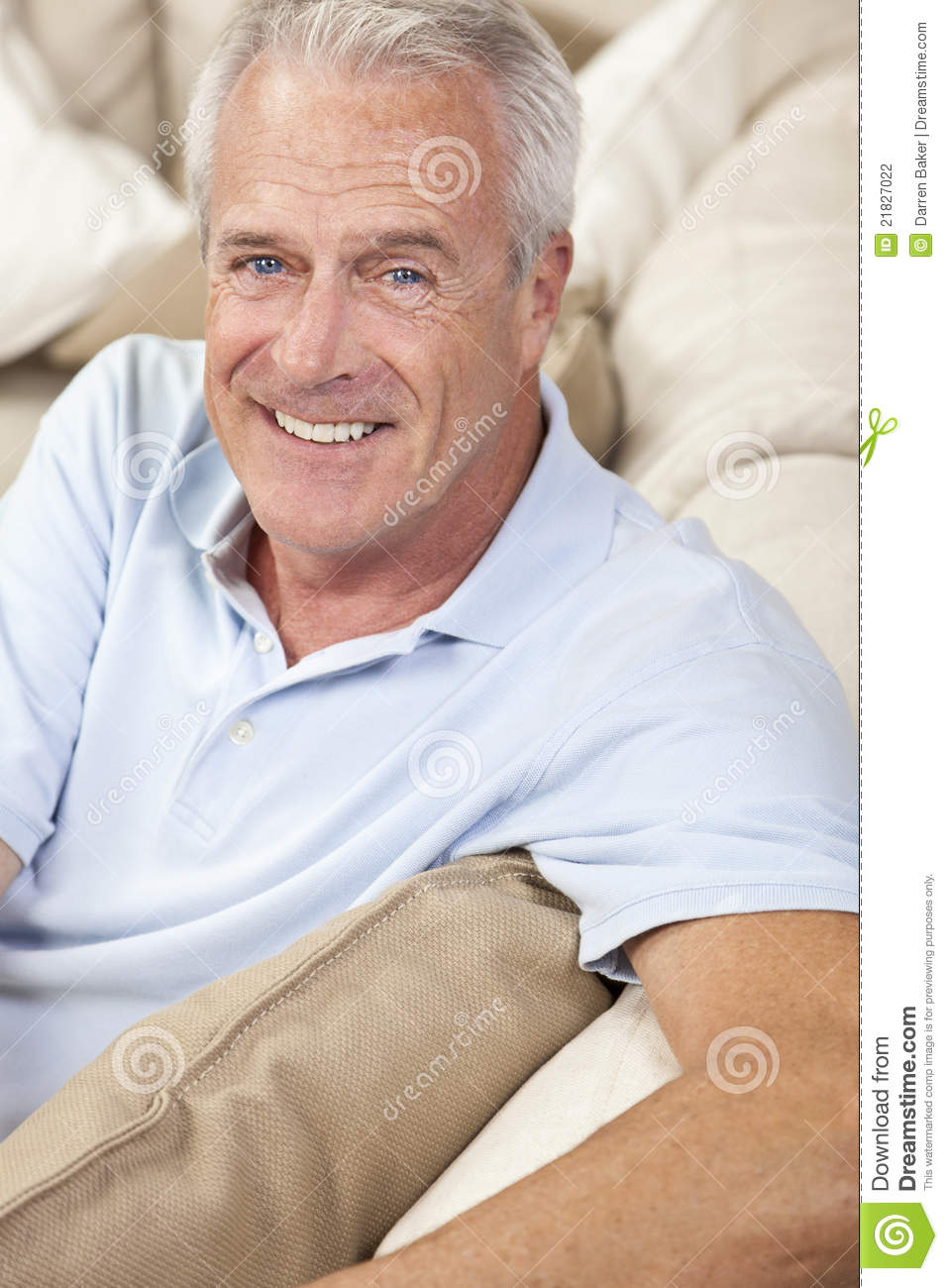 Happy Handsome Senior Man Smiling At Home Stock