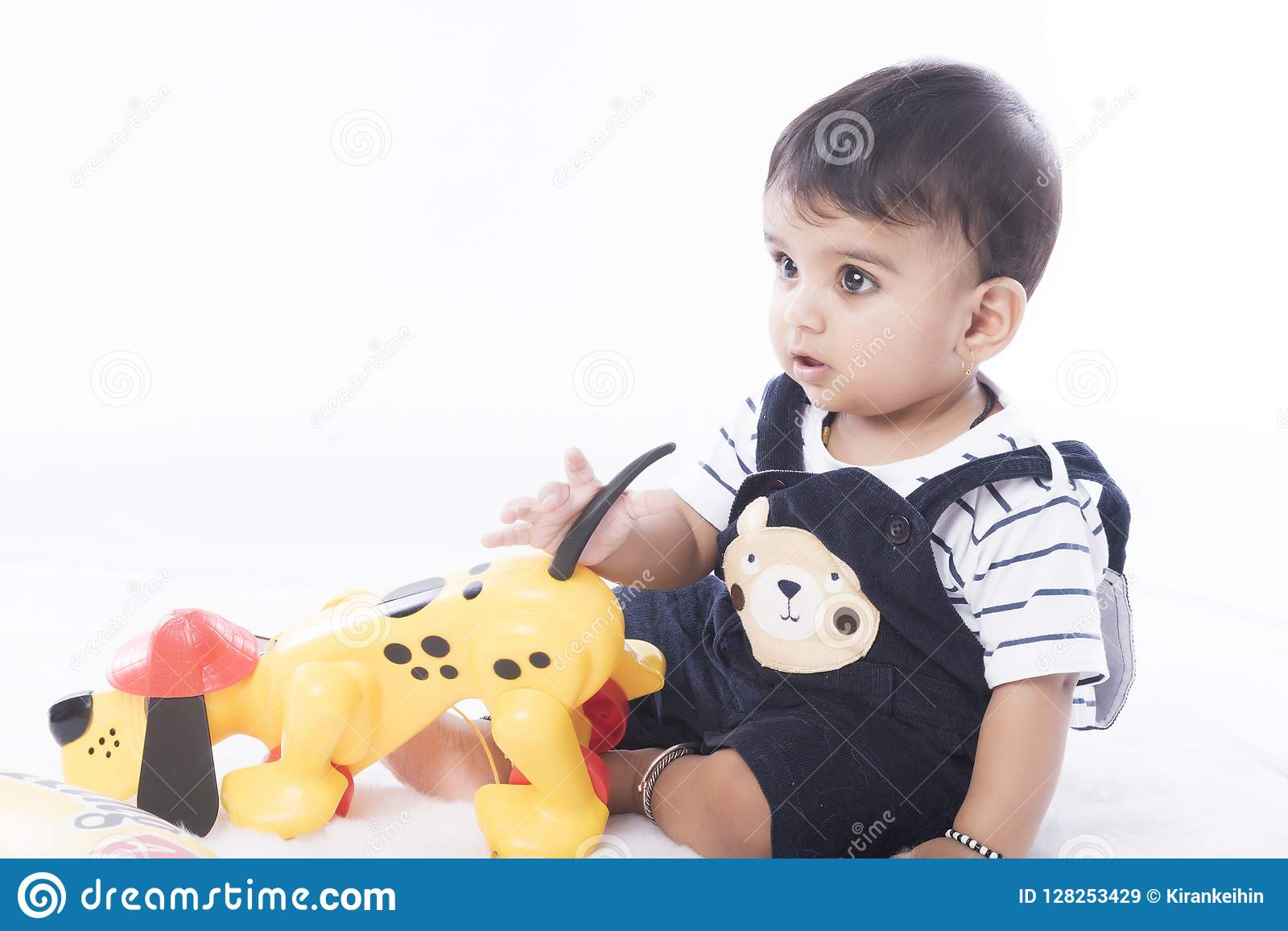 Happy And Healthy Indian Baby Boy With Playful Gesture Stock Image