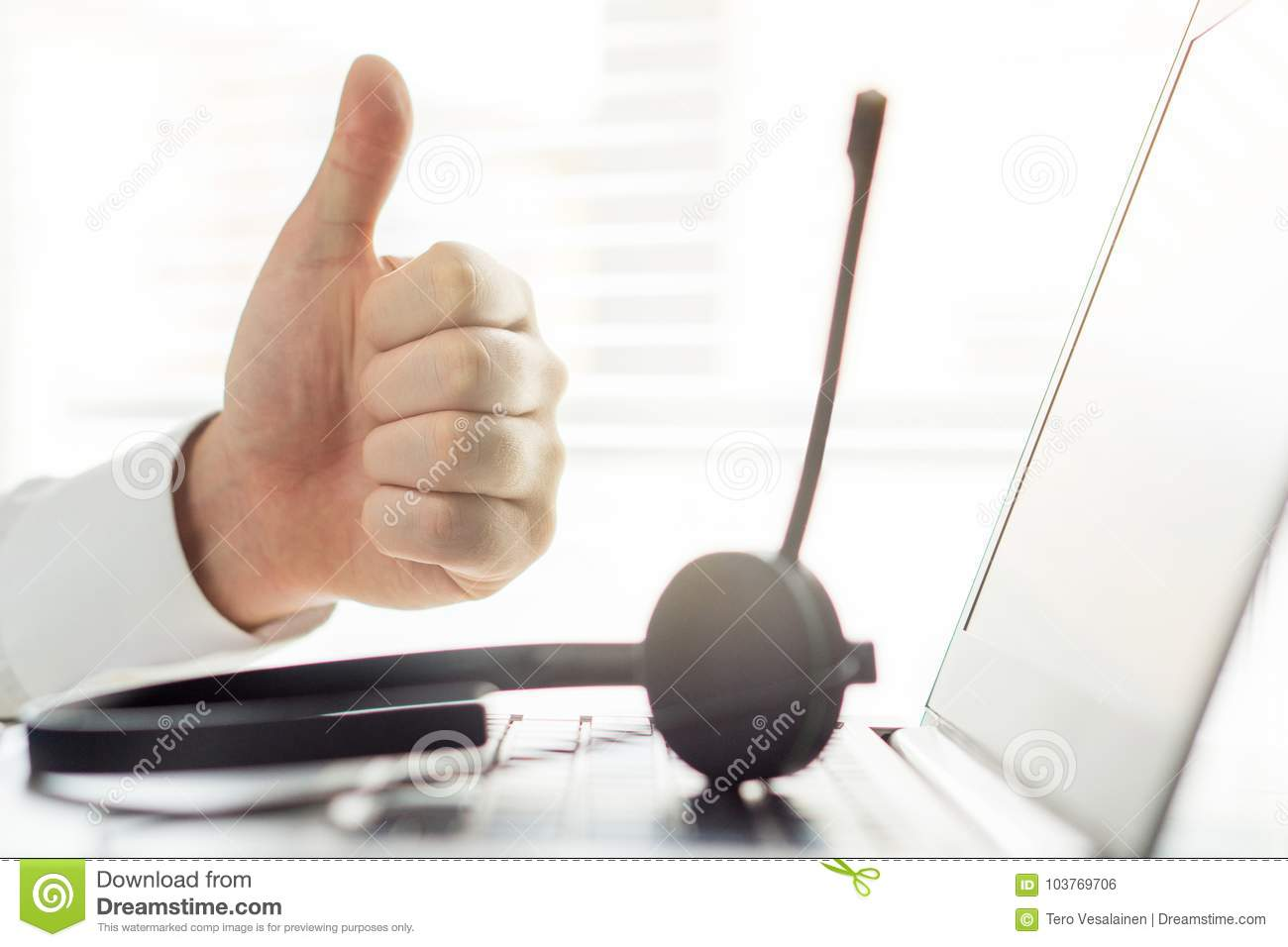 Happy help desk or call center person showing thumbs up.