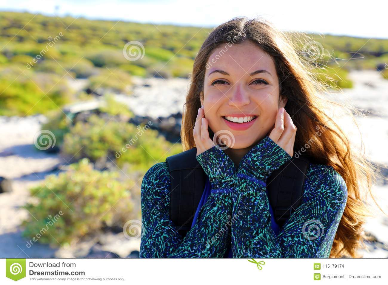 Happy hiker female sunburned smiling at camera in her summer holidays in Lanzarote Island, Spain