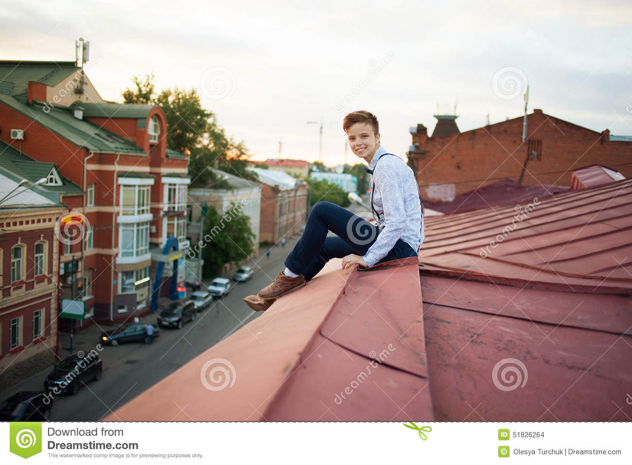 Happy Hipster On The Edge Of The Roof Stock Photo - Image ...