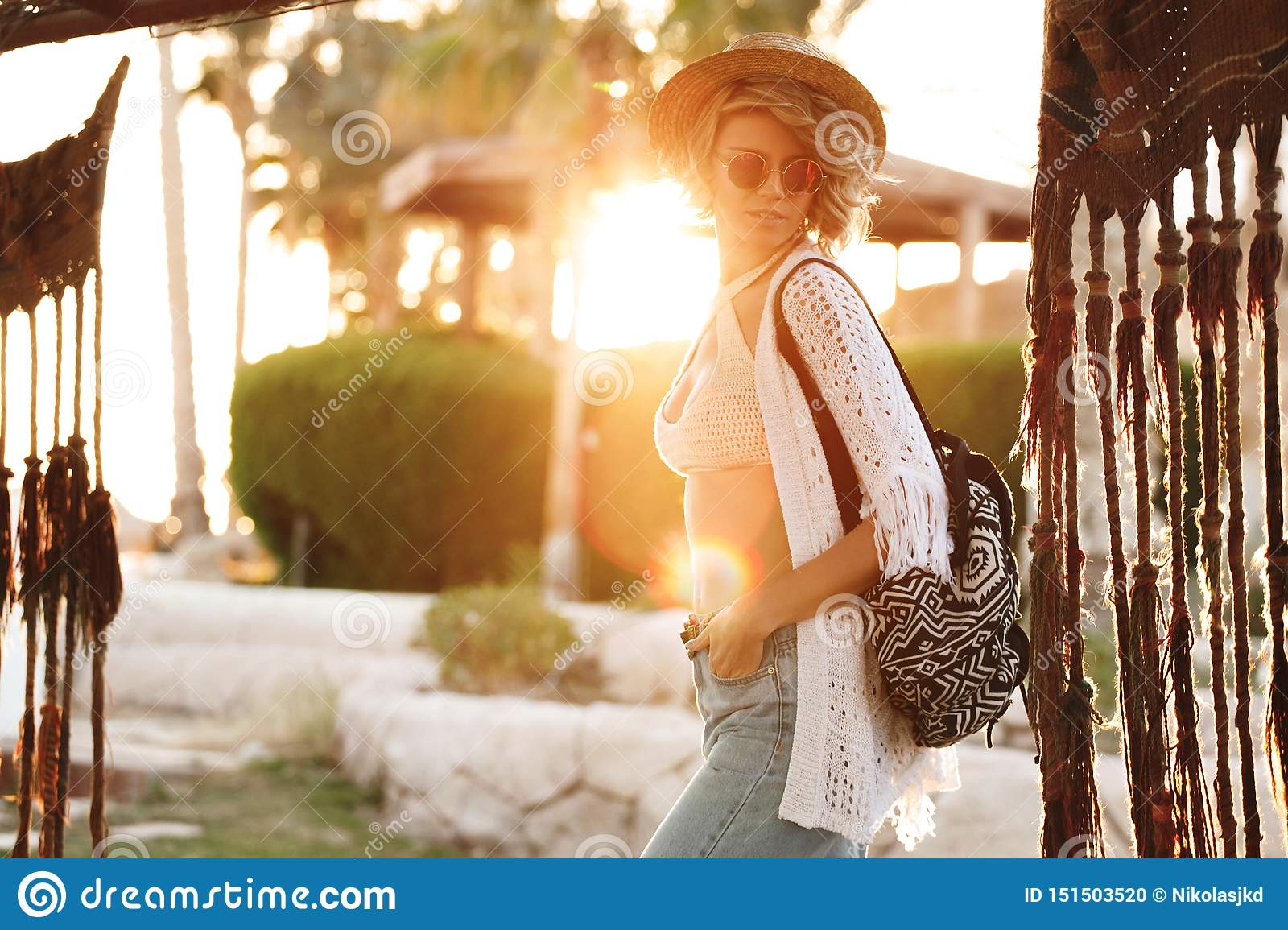 Happy hipster woman having fun on vacation in hat and sunglasses. Sunny lifestyle fashion girl