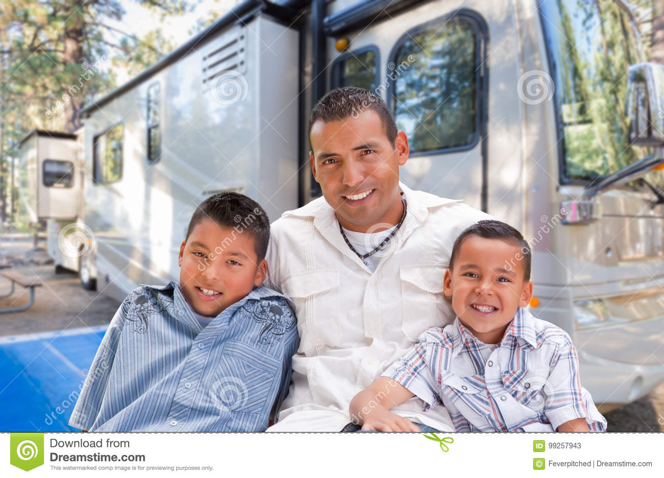 Happy Hispanic Father and Sons In Front of Their Beautiful RV