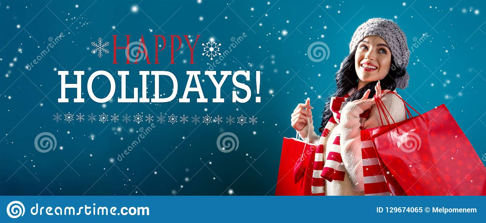 Happy holidays message with woman holding shopping bags