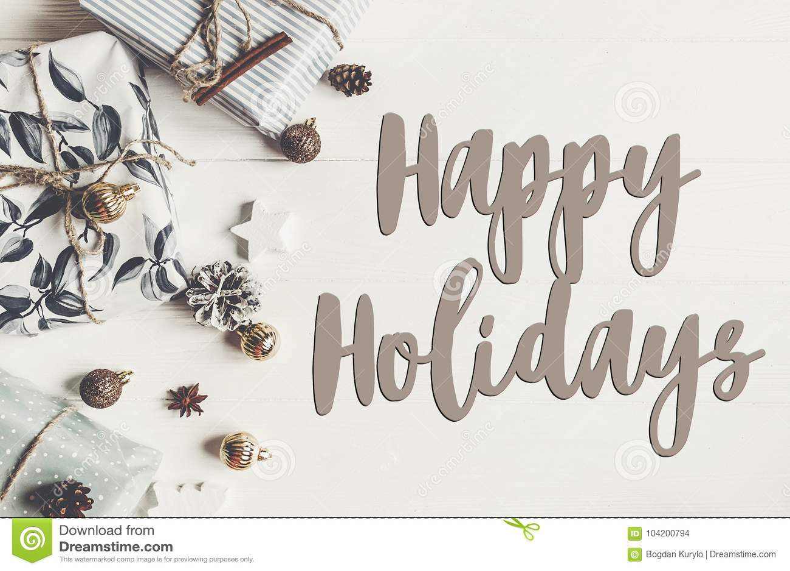 Happy holidays text, seasonal greetings card sign. stylish mode