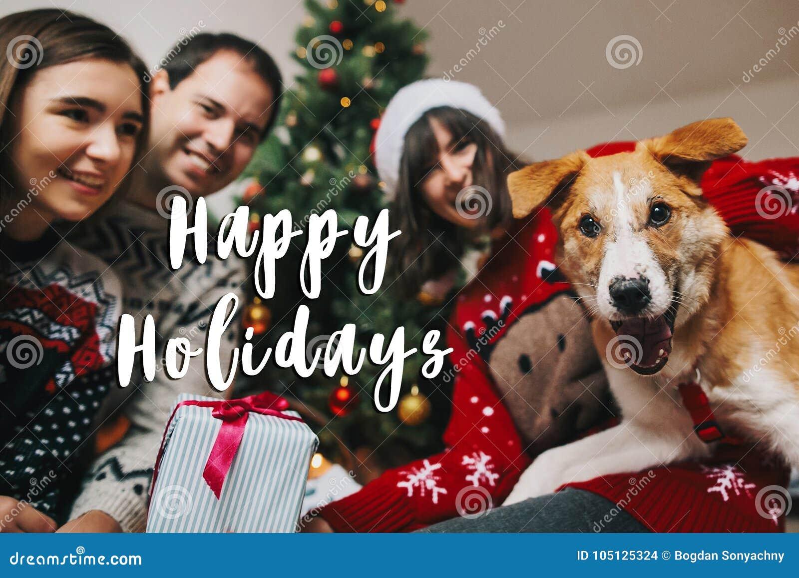 Happy holidays text sign, greeting card. happy family having fun