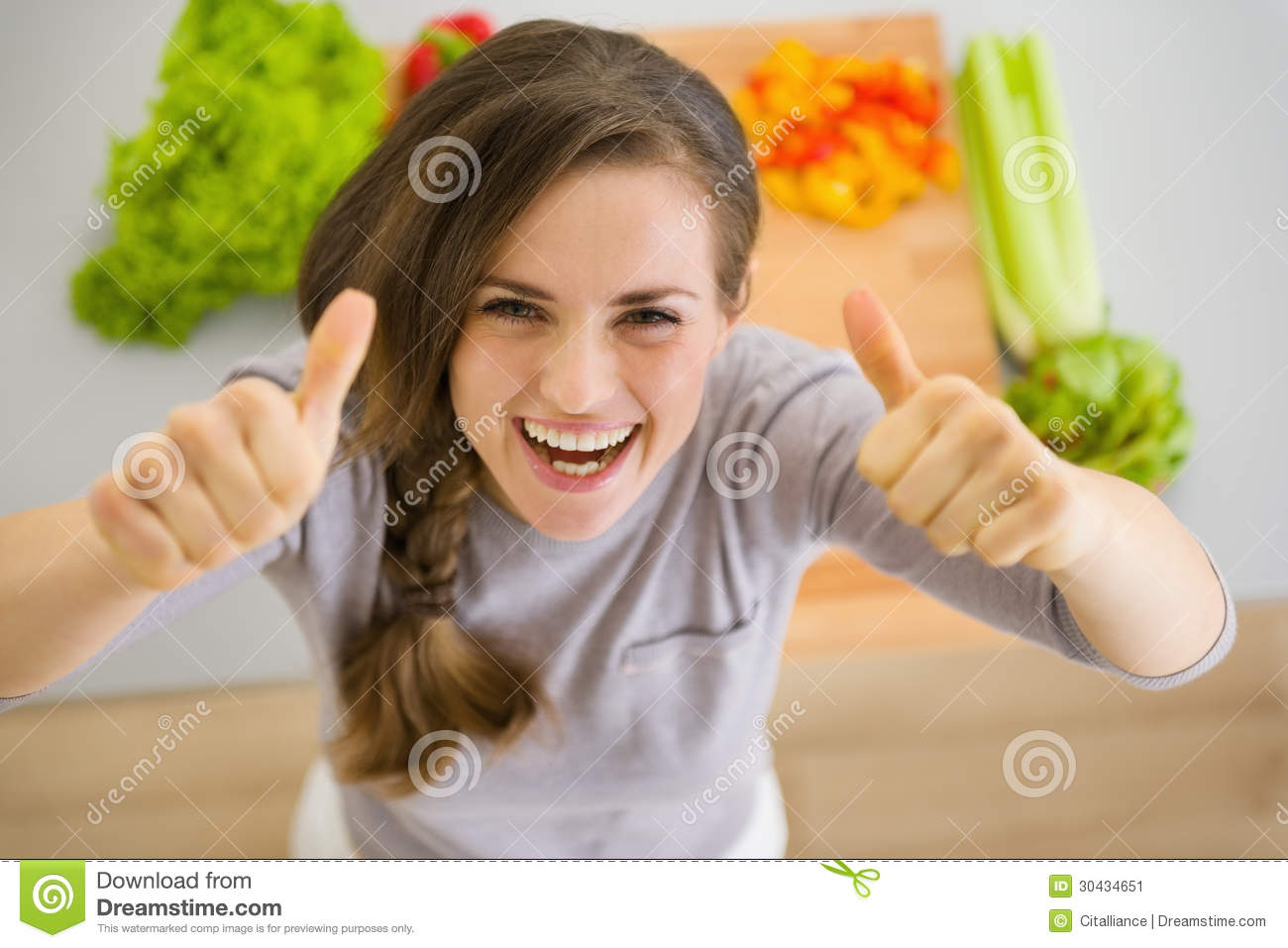 Happy housewife in kitchen showing thumbs up stock image for Modern housewife