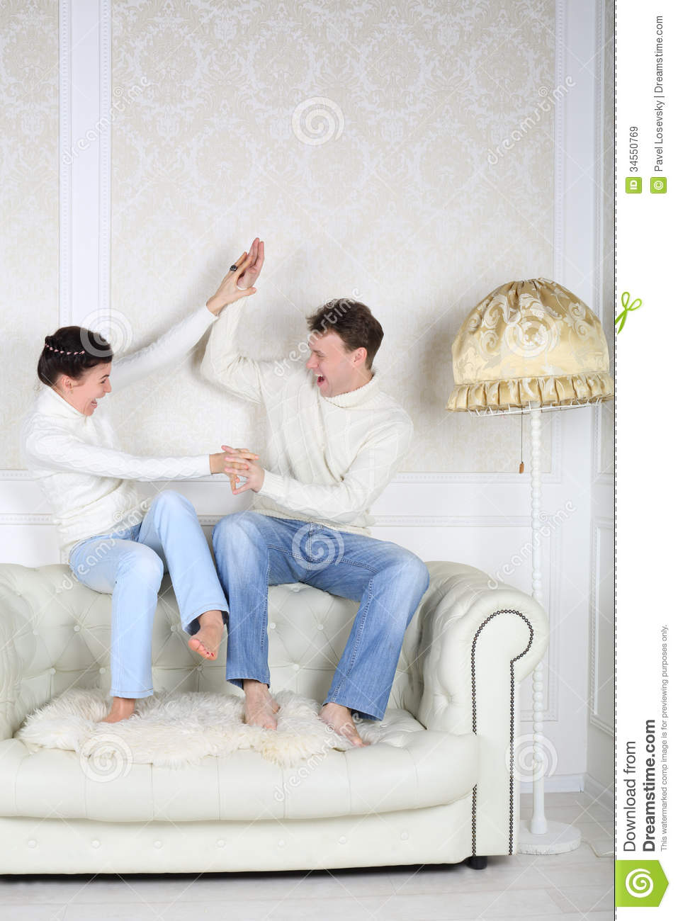 Happy Husband And Wife Sits And Fight Royalty Free Stock