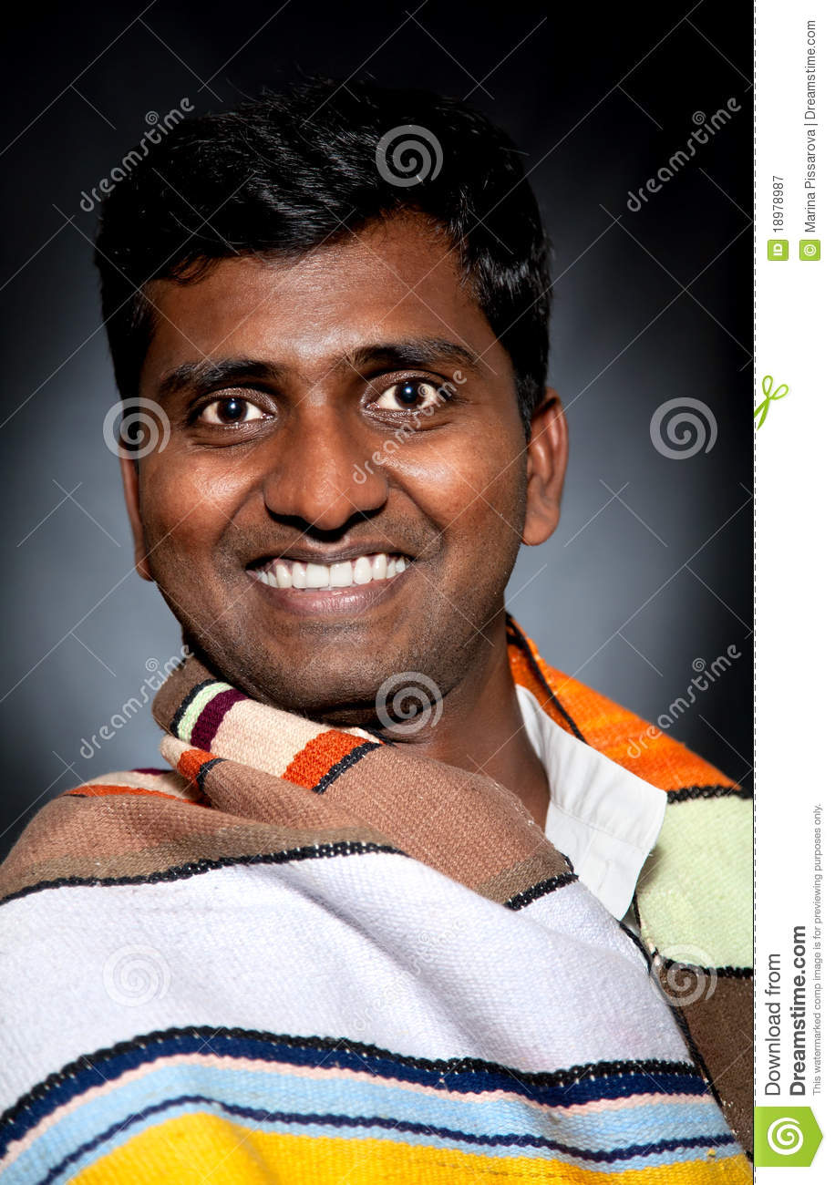 happy-indian-man-smiling-18978987.jpg
