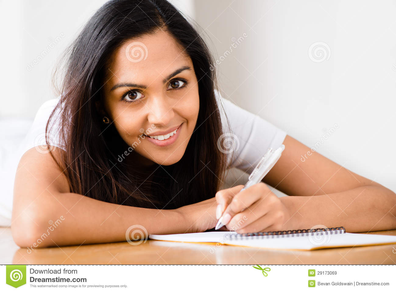 happy indian woman student education writing studying 29173069 Effective  scholarship  essay help  Programs   Where To Go