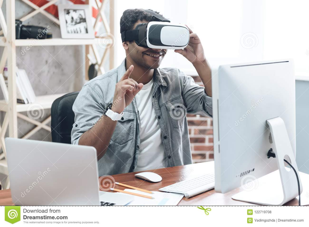 Happy Indian Young Man at Home in VR Glasses