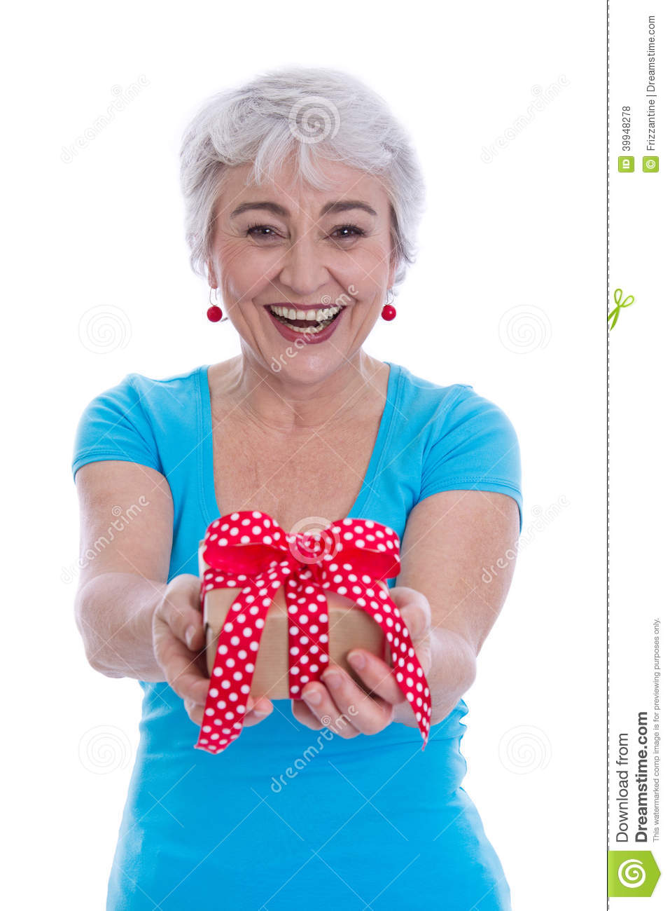 Happy Isolated Older Woman Holding A Present Stock Photo