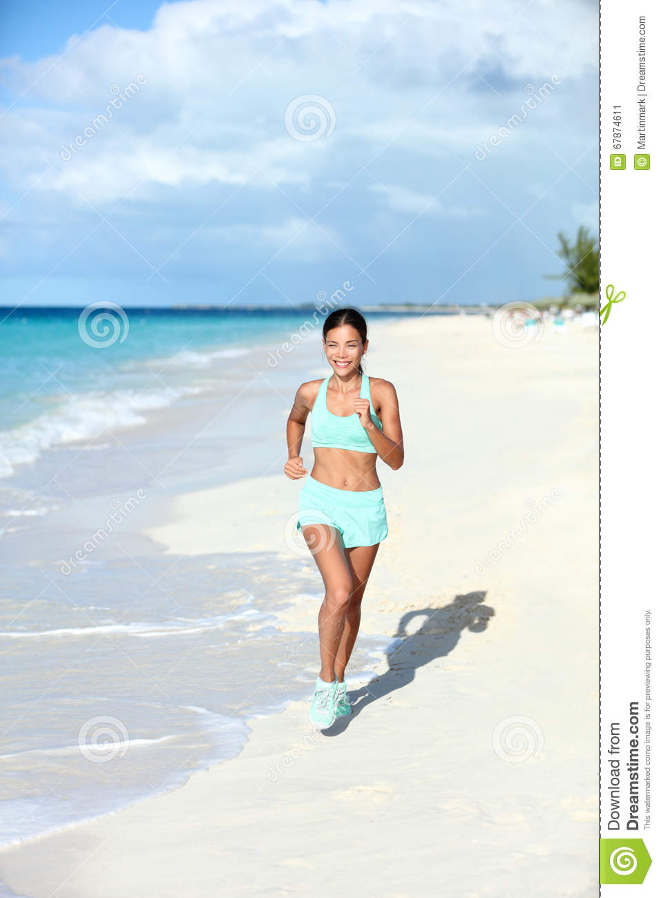 Happy jogging woman running on sunny beach living a fit life stock download comp publicscrutiny Choice Image