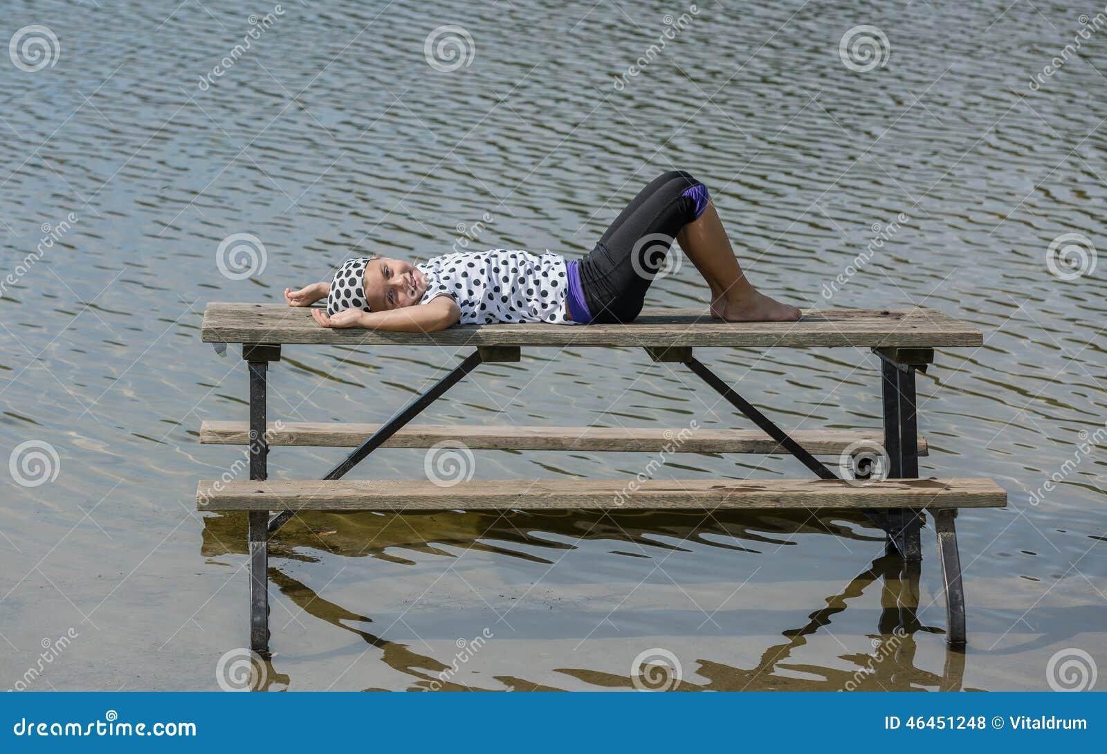 Happy Joyful Little Girl Lying And Relaxing On Picnic ...