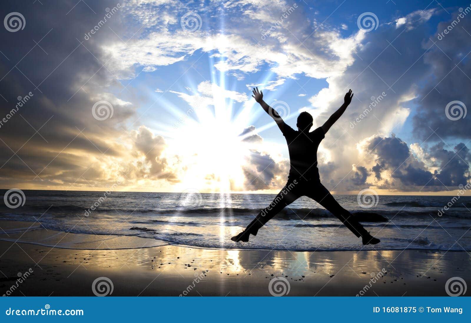 Happy jumper and beautiful sunrise