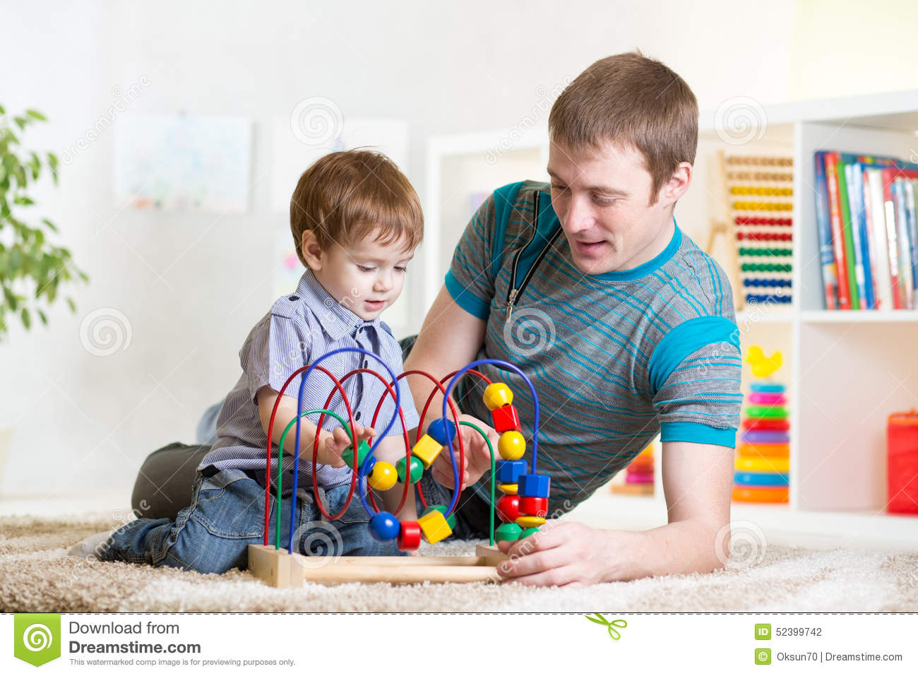 Boy Toys For Dads : Happy kid boy and dad playing toy stock photo image