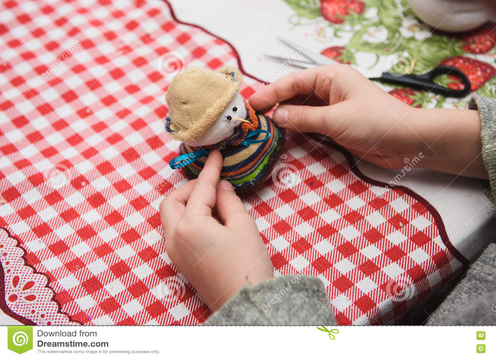 Happy kid doing craft