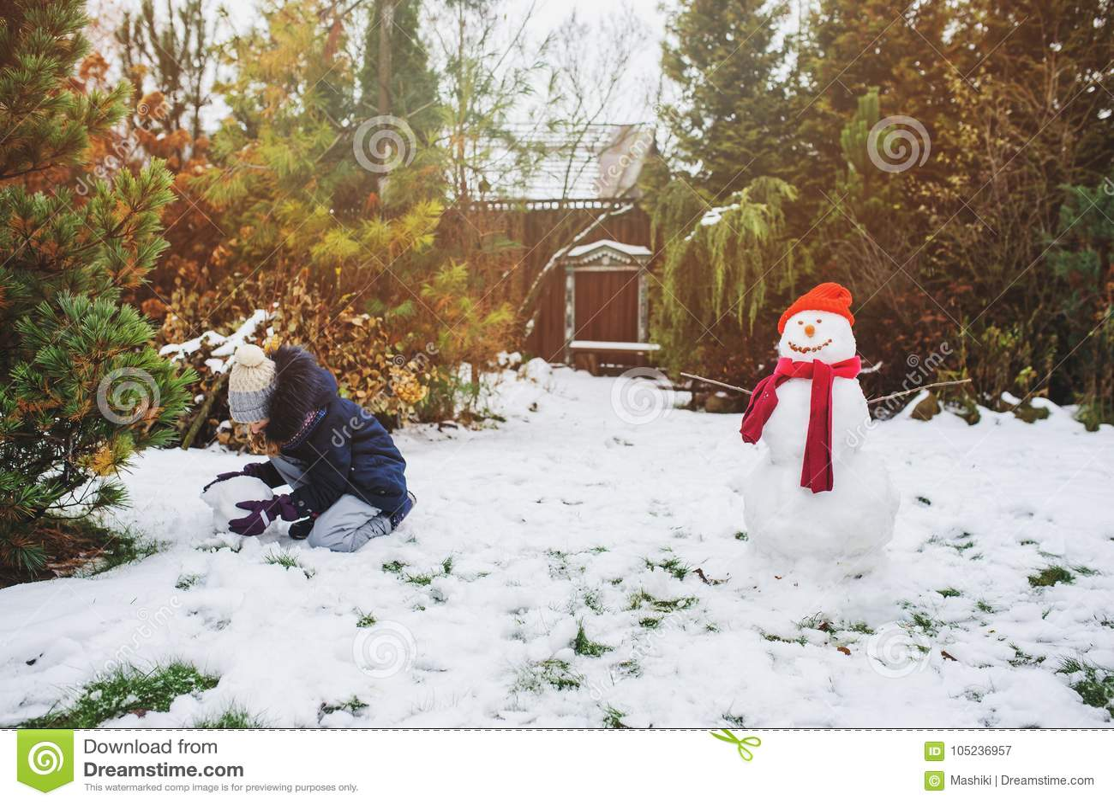 Christmas Vacations.Happy Kid Girl Making Snow Man On Christmas Vacations On