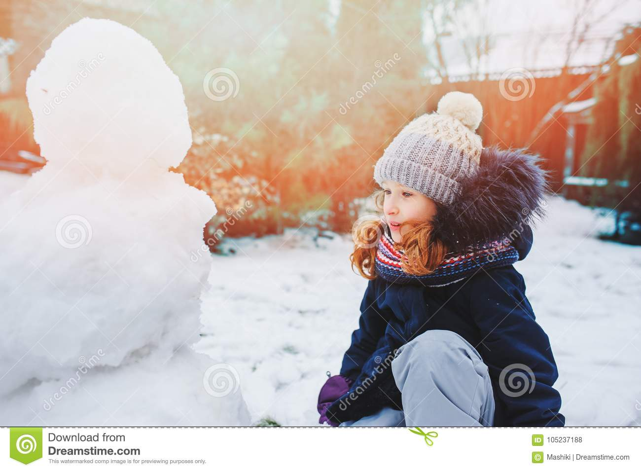 Happy Kid Girl Making Snow Man On Christmas Vacations Backyard Winter Outdoor Activities For Kids