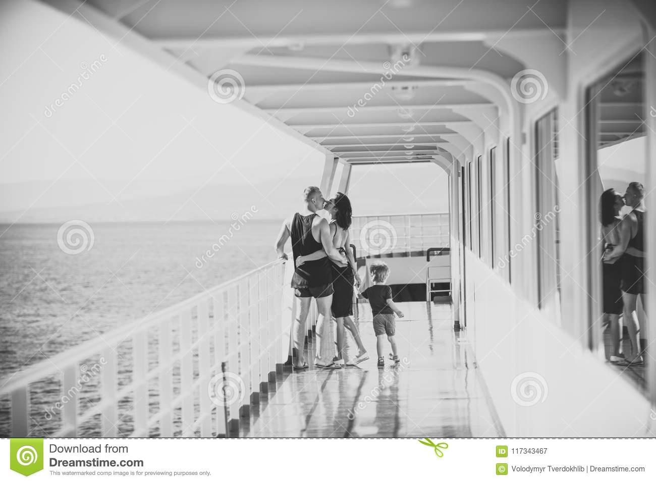 Happy kid having fun. Family travelling on cruise ship on sunny day. Family and love concept. Father, mother and child