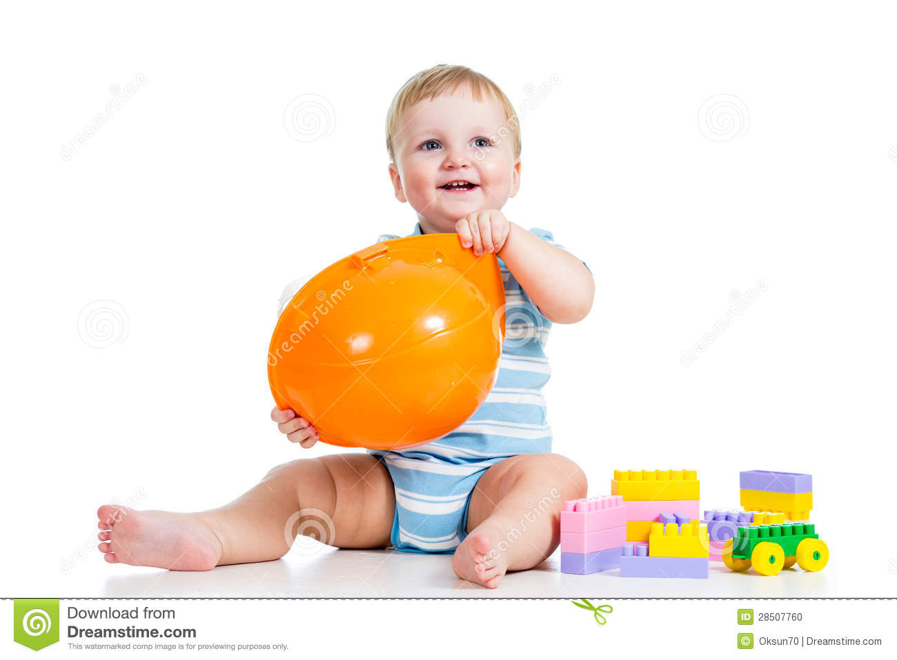 Happy kid playing with building blocks toy