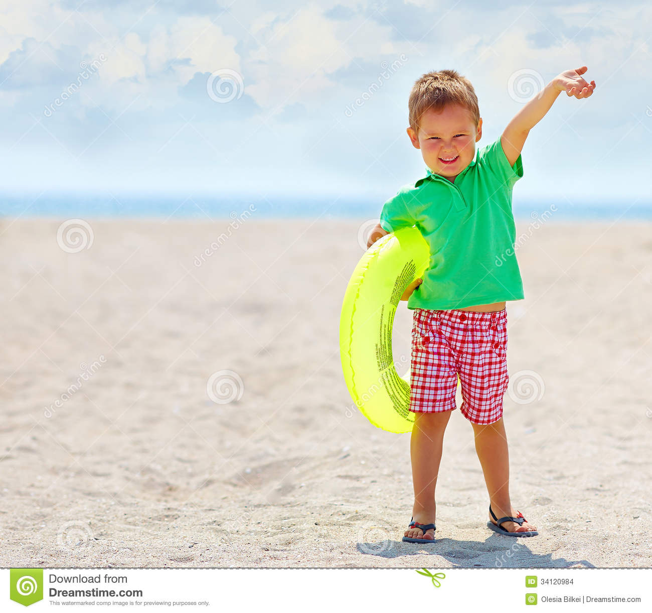 Happy Beautiful Woman Enjoying At Beach Stock Photo: Happy Kid With Rubber Ring On The Beach Stock Photo