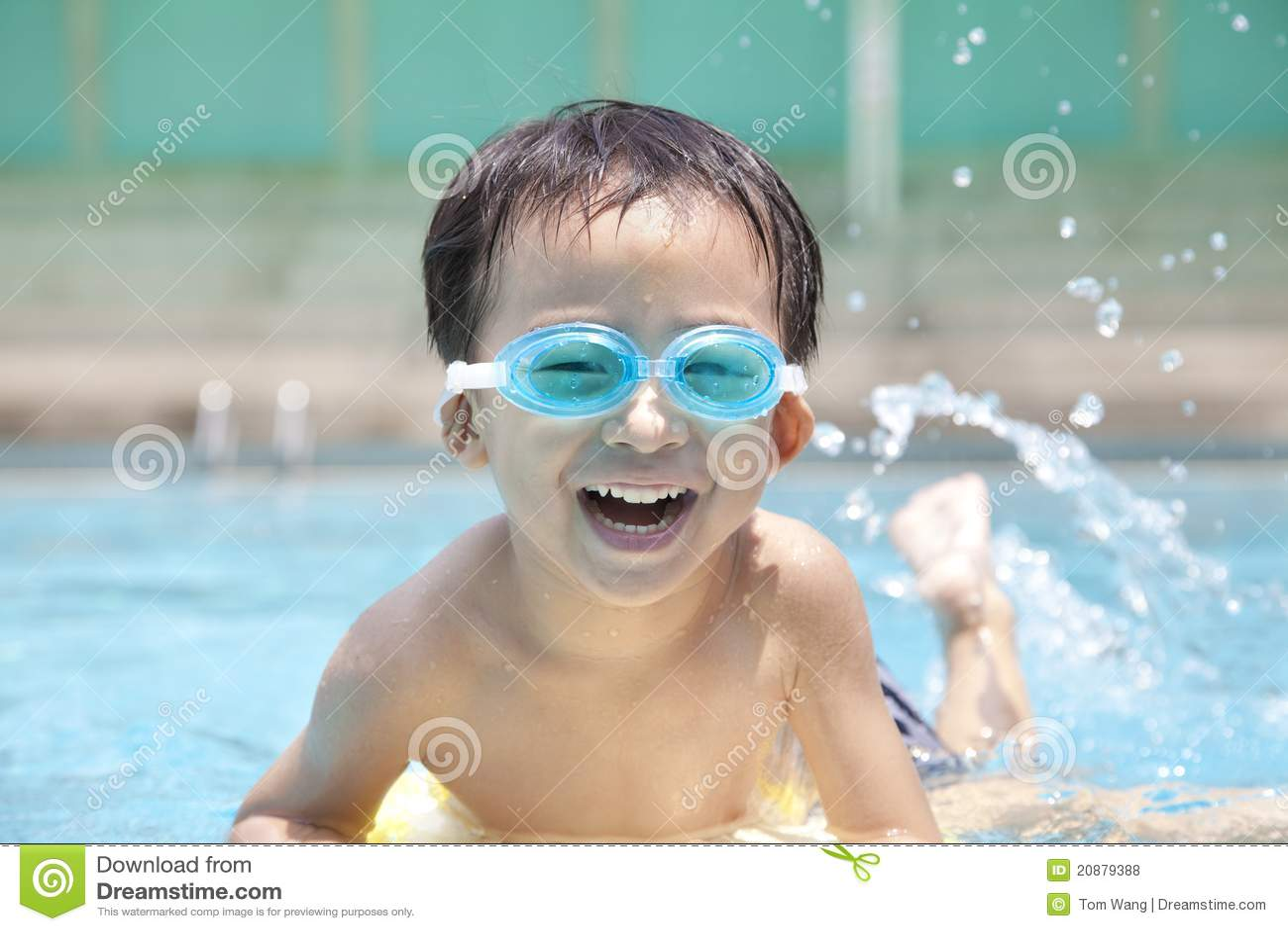 Happy kid in swimming pool