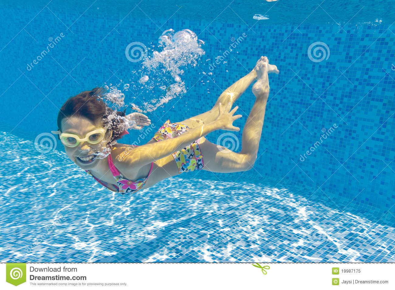 Kids Swimming Underwater happy kid swimming underwater in pool royalty free stock photo