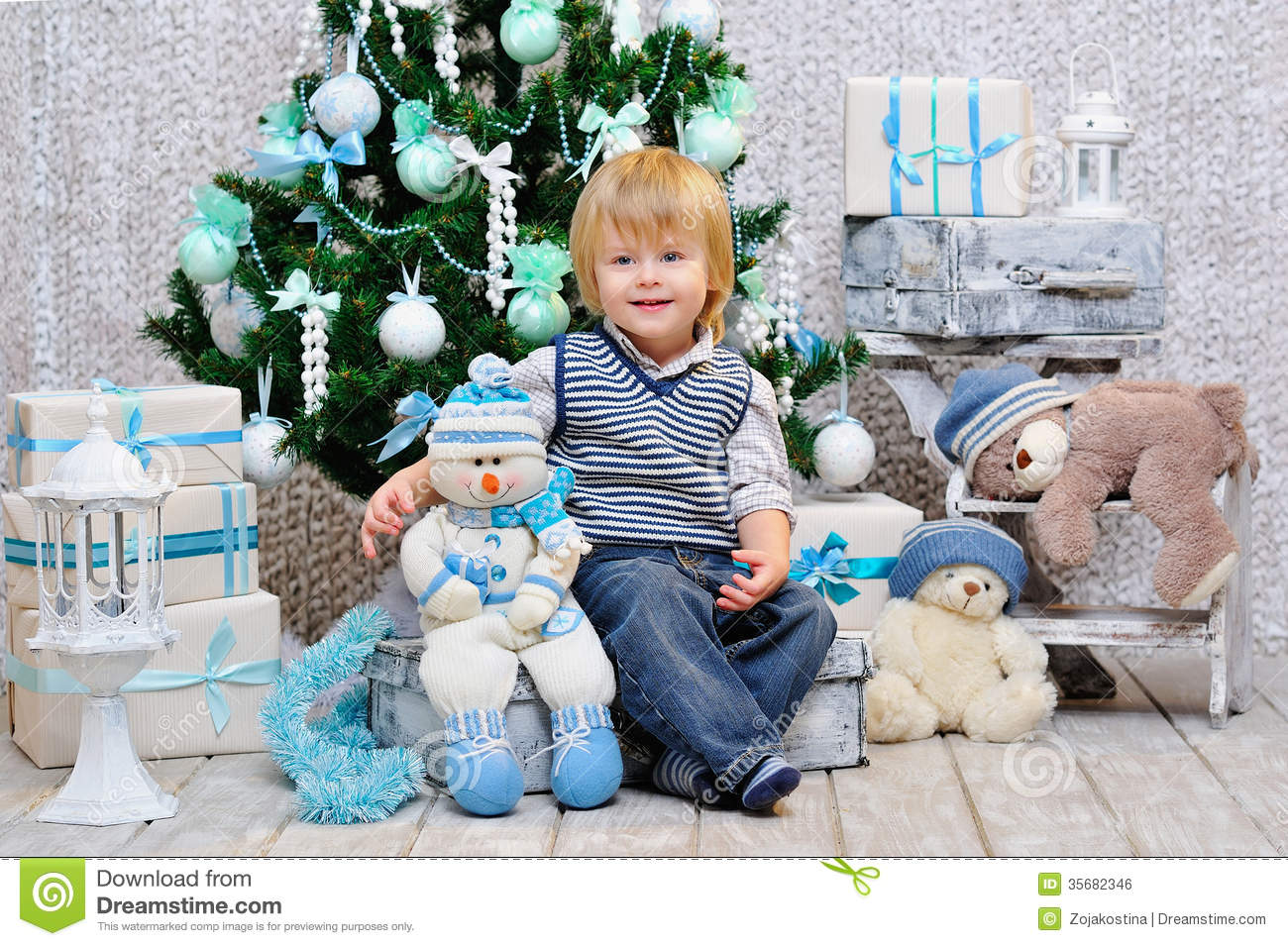 Happy Kid With Toys By The Christmas Tree Stock Photo Image Of