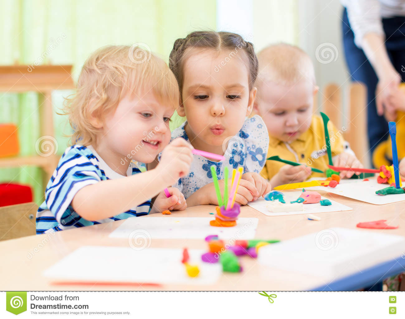 Kinder Garden: Happy Kids Doing Arts And Crafts In Day Care Centre Stock