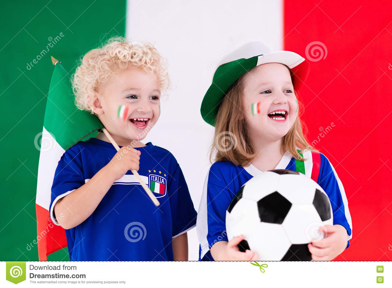 5443e734ed0 Children cheering and supporting Italian national football team. Kids fans  and supporters of Italy during soccer championship.