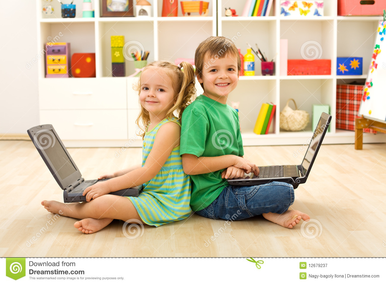 happy kids with laptops sitting on the floor royalty free stock photography image 12679237. Black Bedroom Furniture Sets. Home Design Ideas