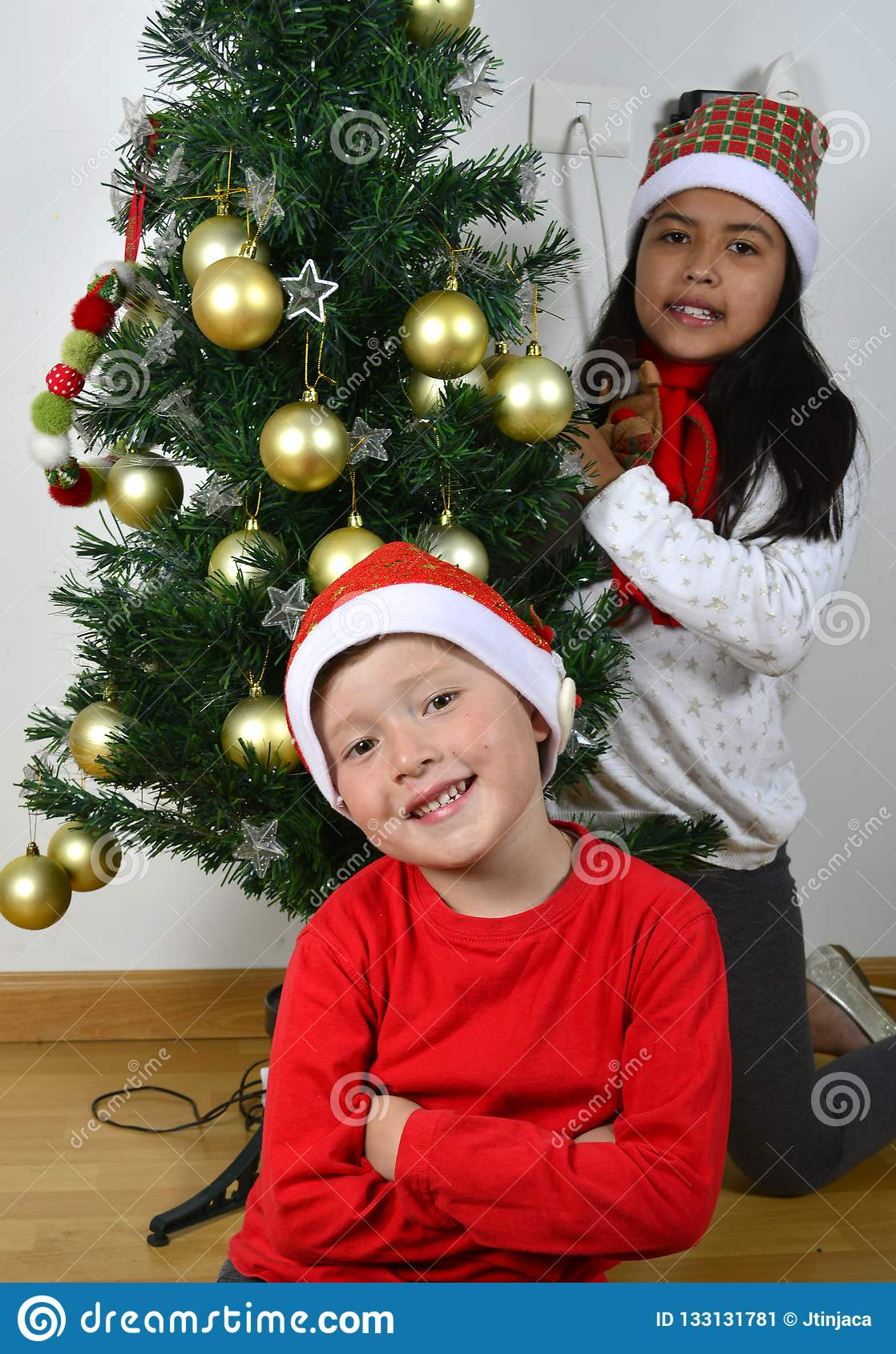 Happy Kids Laying Under The Christmas Tree Stock Image Image Of Colombian Happy 133131781