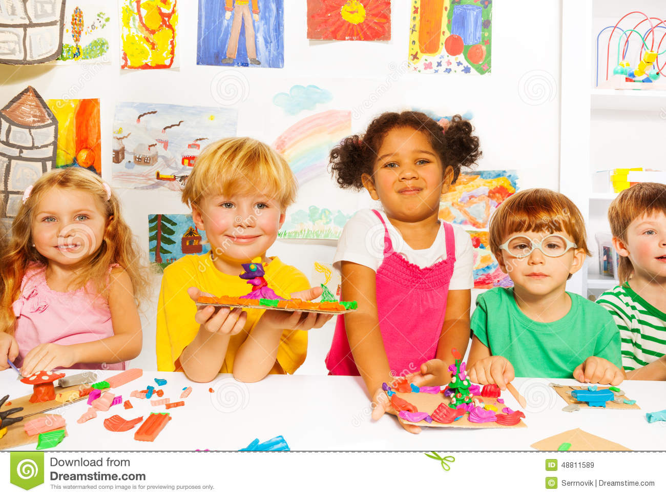 Kinder Garden: Happy Kids With Modeling Clay In Classroom Stock Image