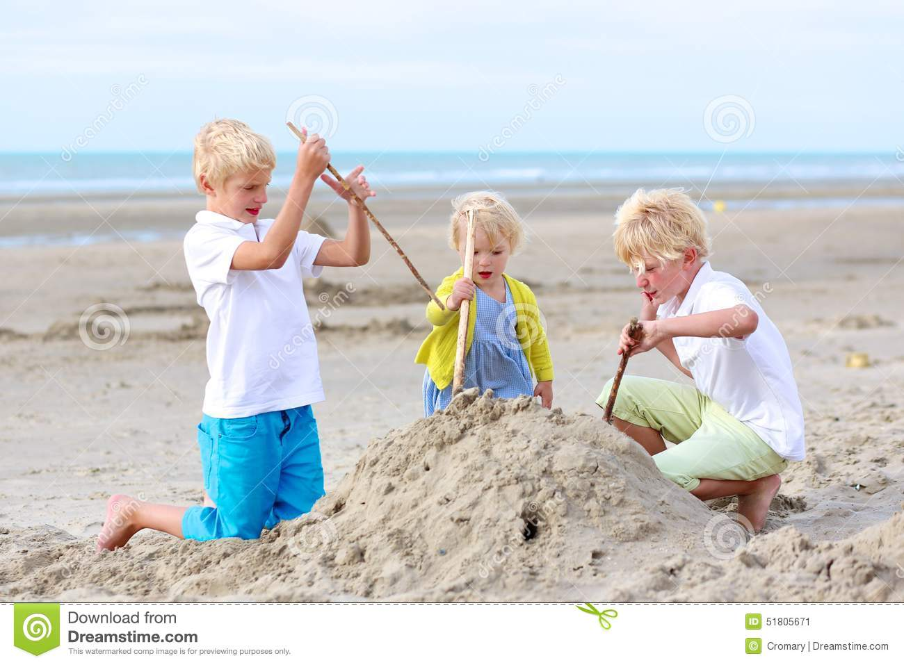 happy kids playing with sand on the beach stock image. Black Bedroom Furniture Sets. Home Design Ideas