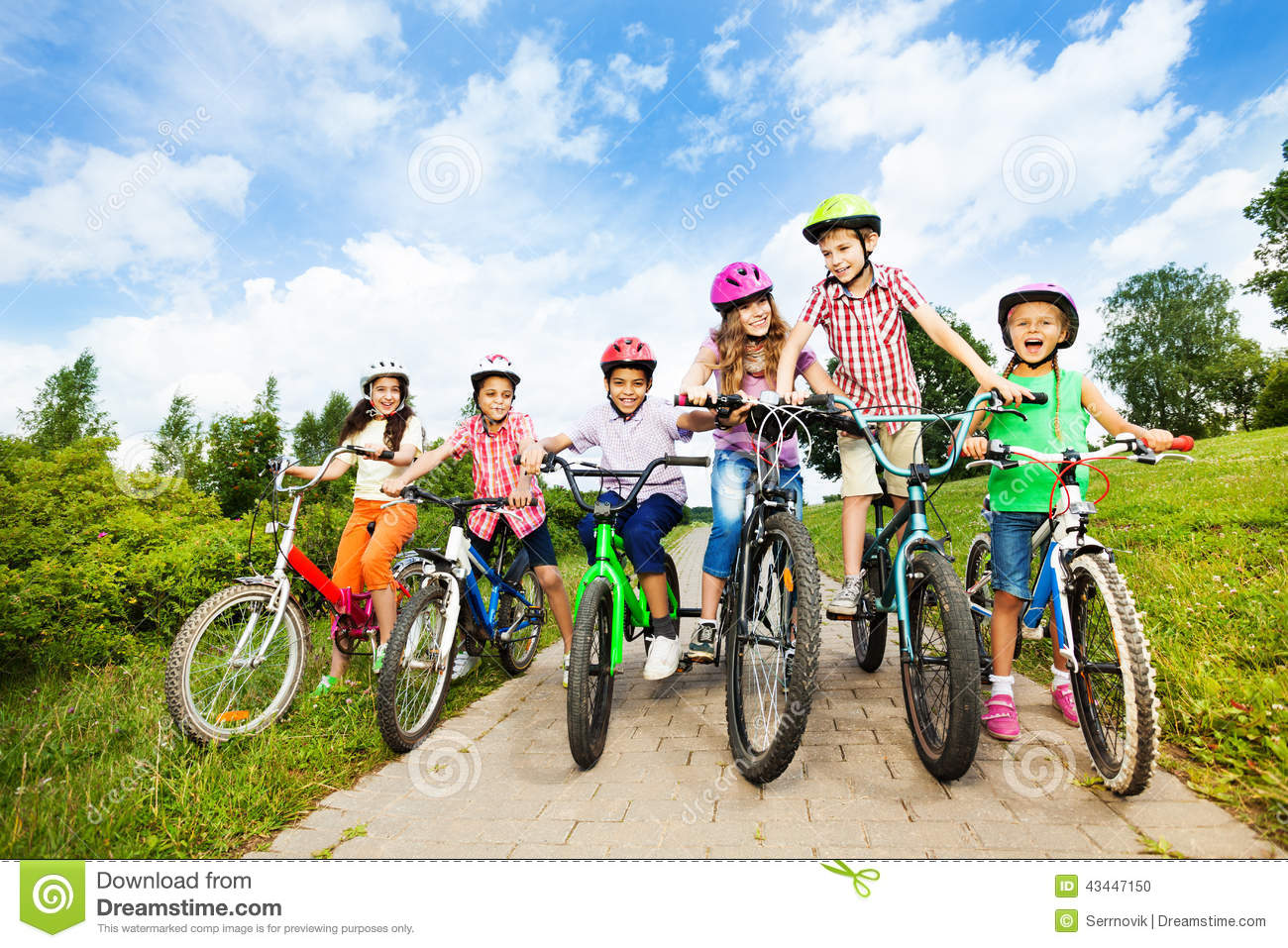... holding bike handle-bars and are ready to ride their bikes in summer
