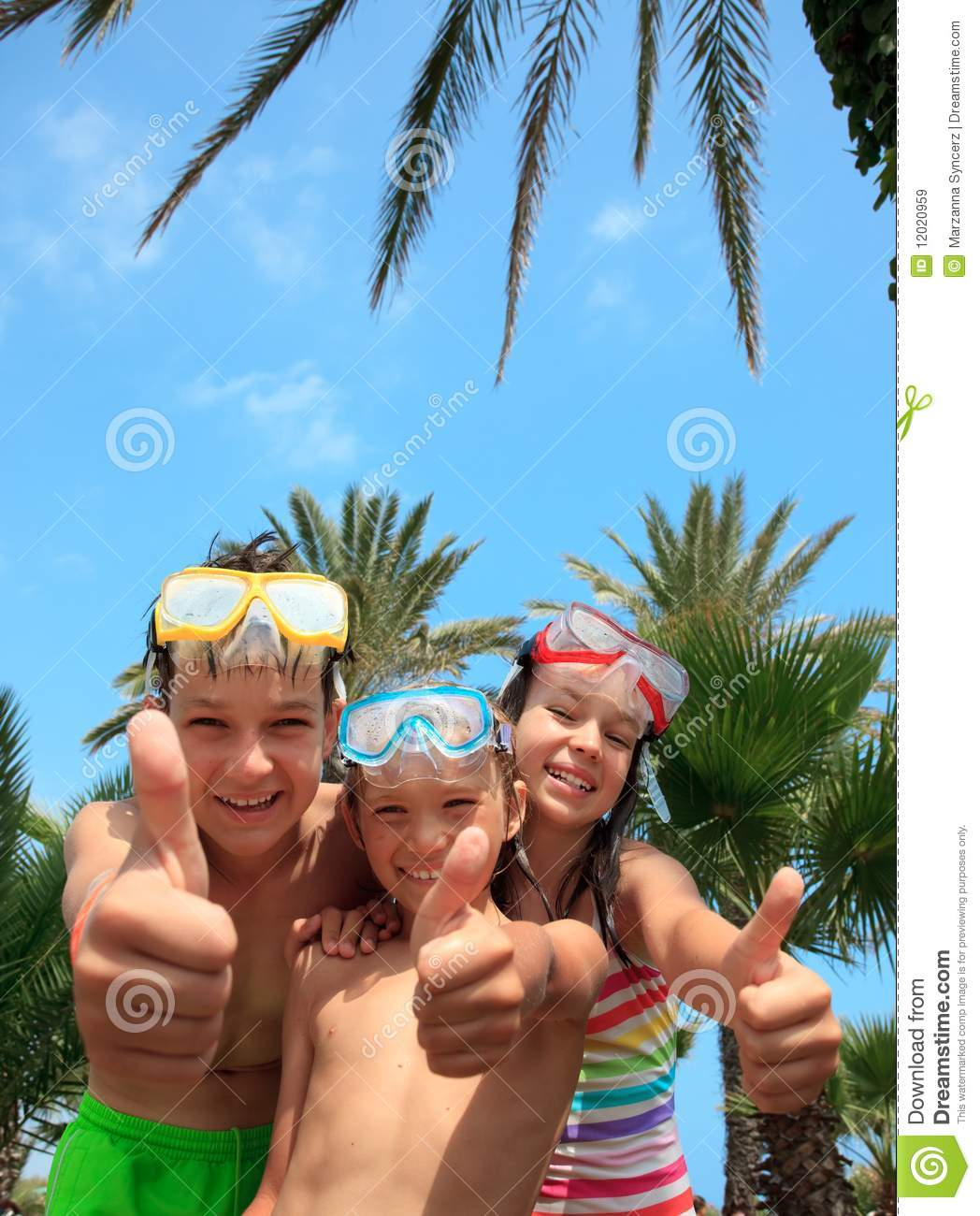 Happy kids in snorkel masks