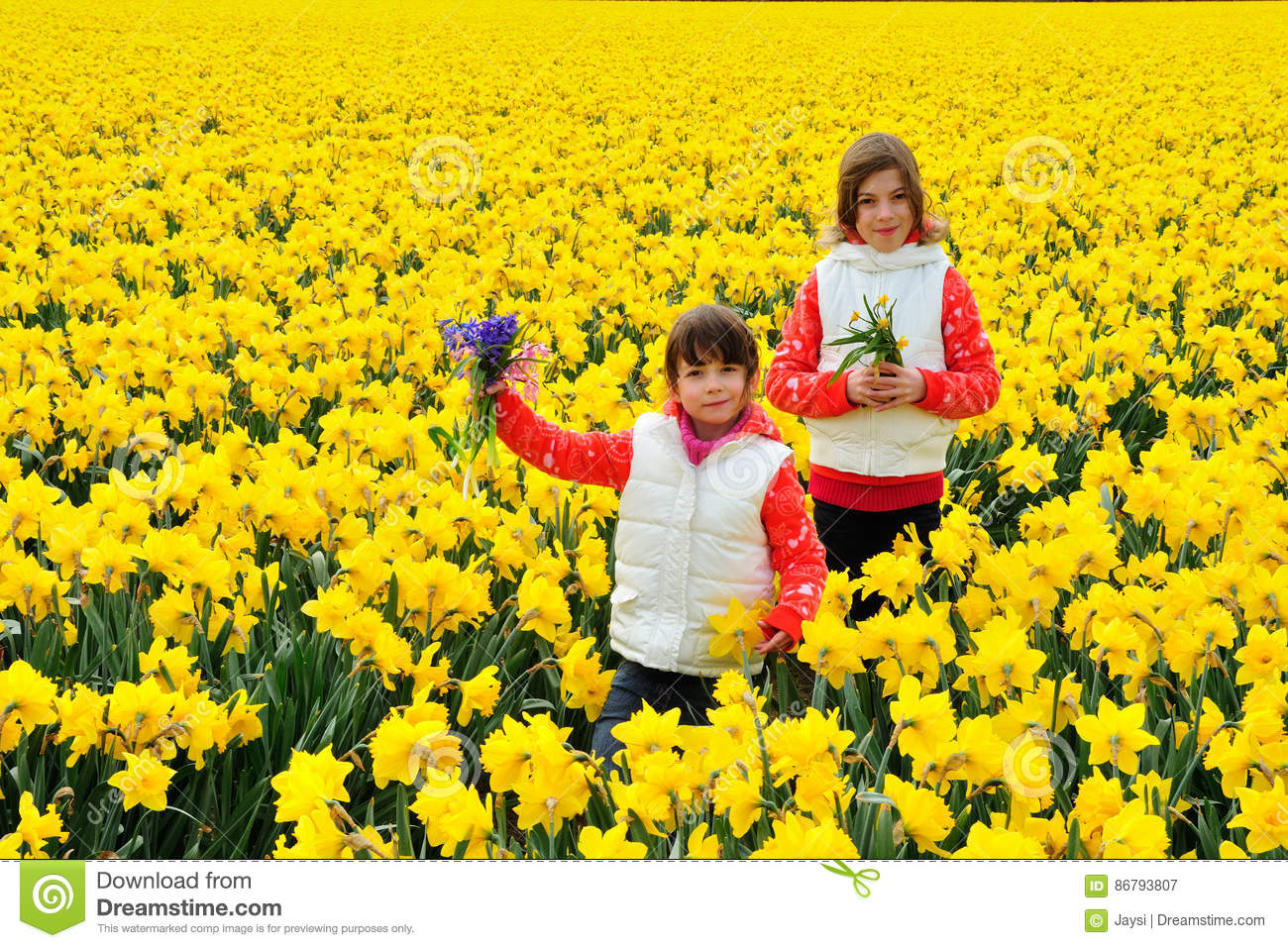 Happy kids with spring flowers on yellow daffodils field children happy kids with spring flowers on yellow daffodils field children on vacation in netherlands mightylinksfo