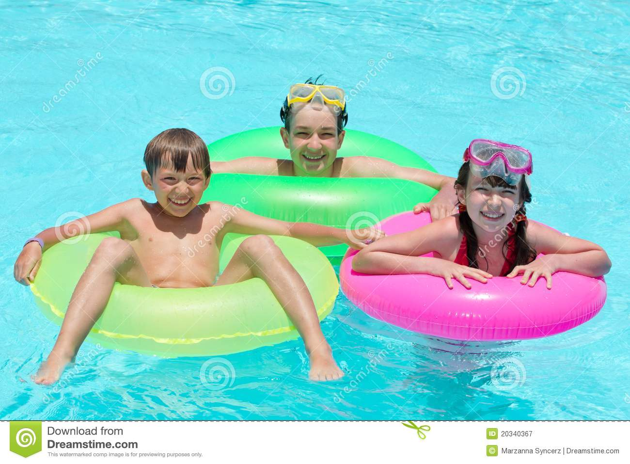 Happy Kids Swimming In Pool