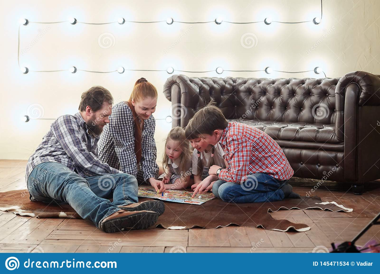 Happy large family playing Board game.