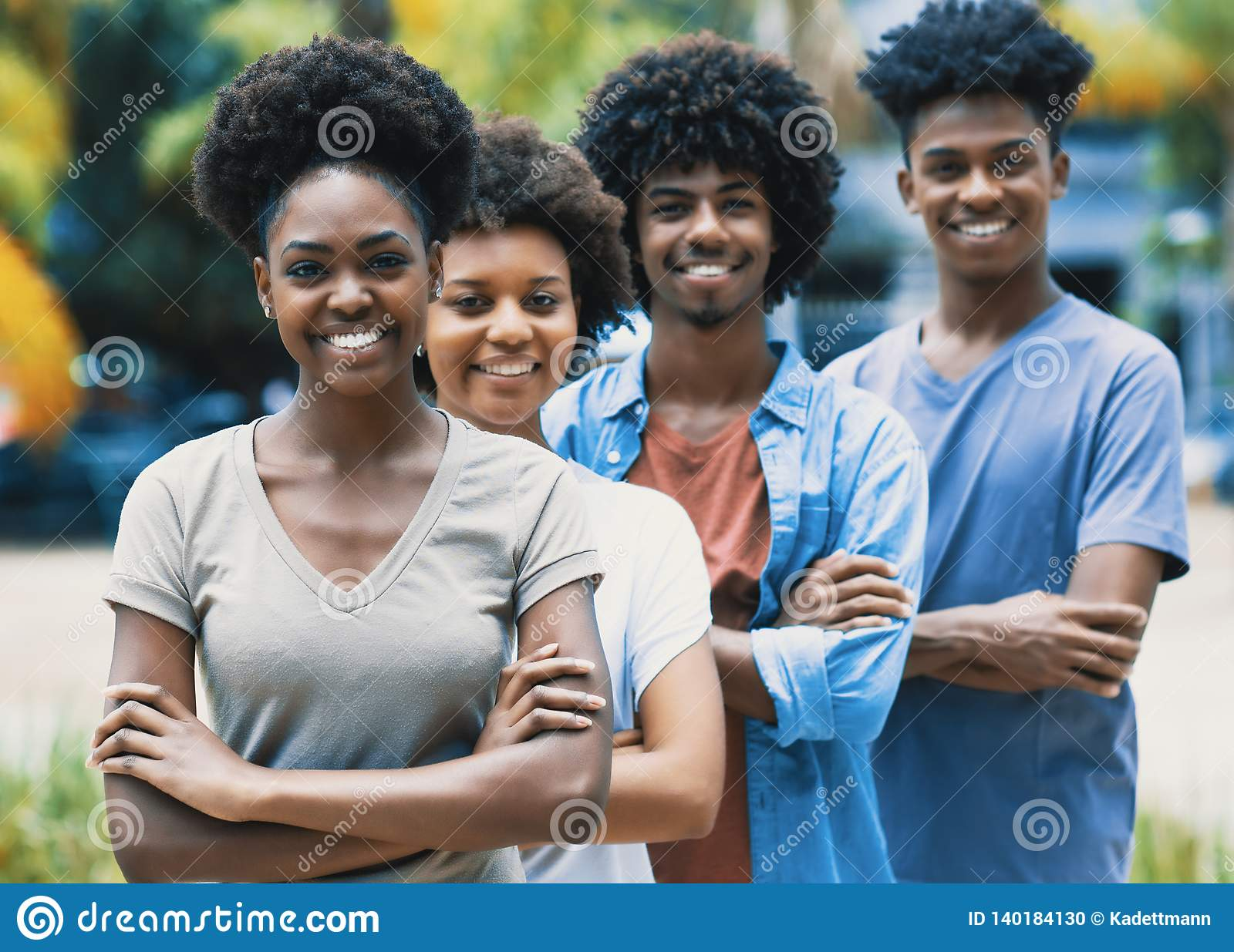 Happy laughing african american young adults in line