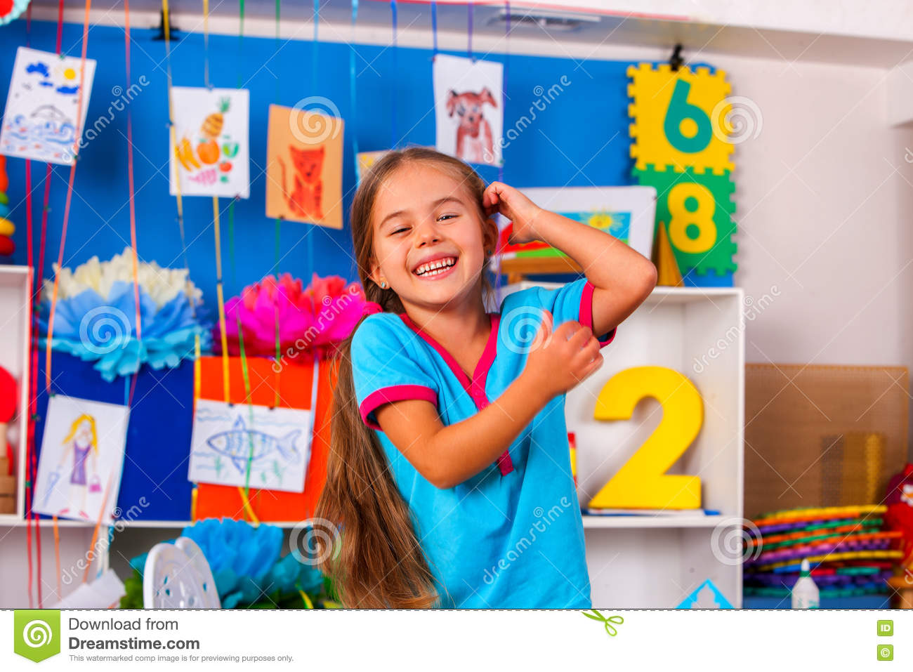 Happy laughing child in preschool class.
