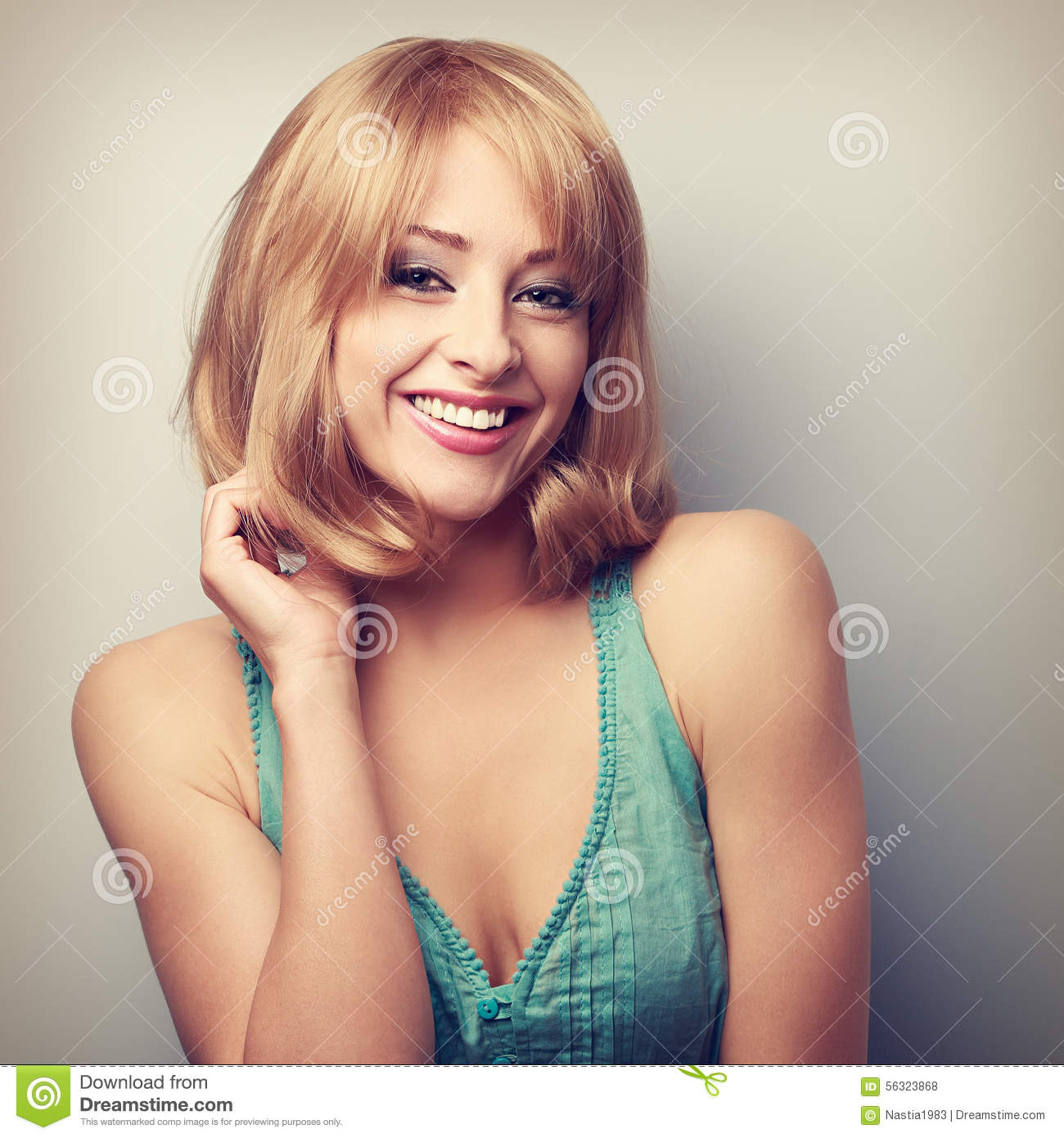 Happy laughing short hair blond woman. Bright makeup. Closeup to