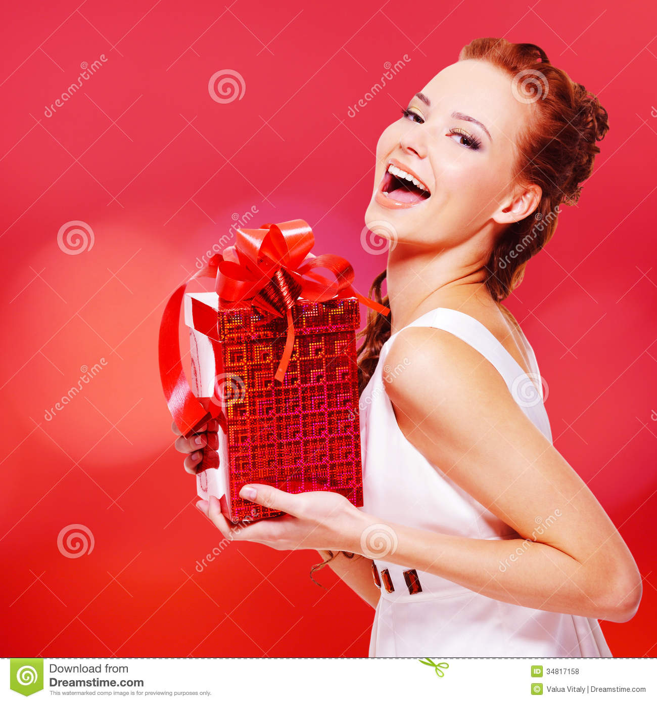 Happy Laughing Woman With Birthday Present In Hands