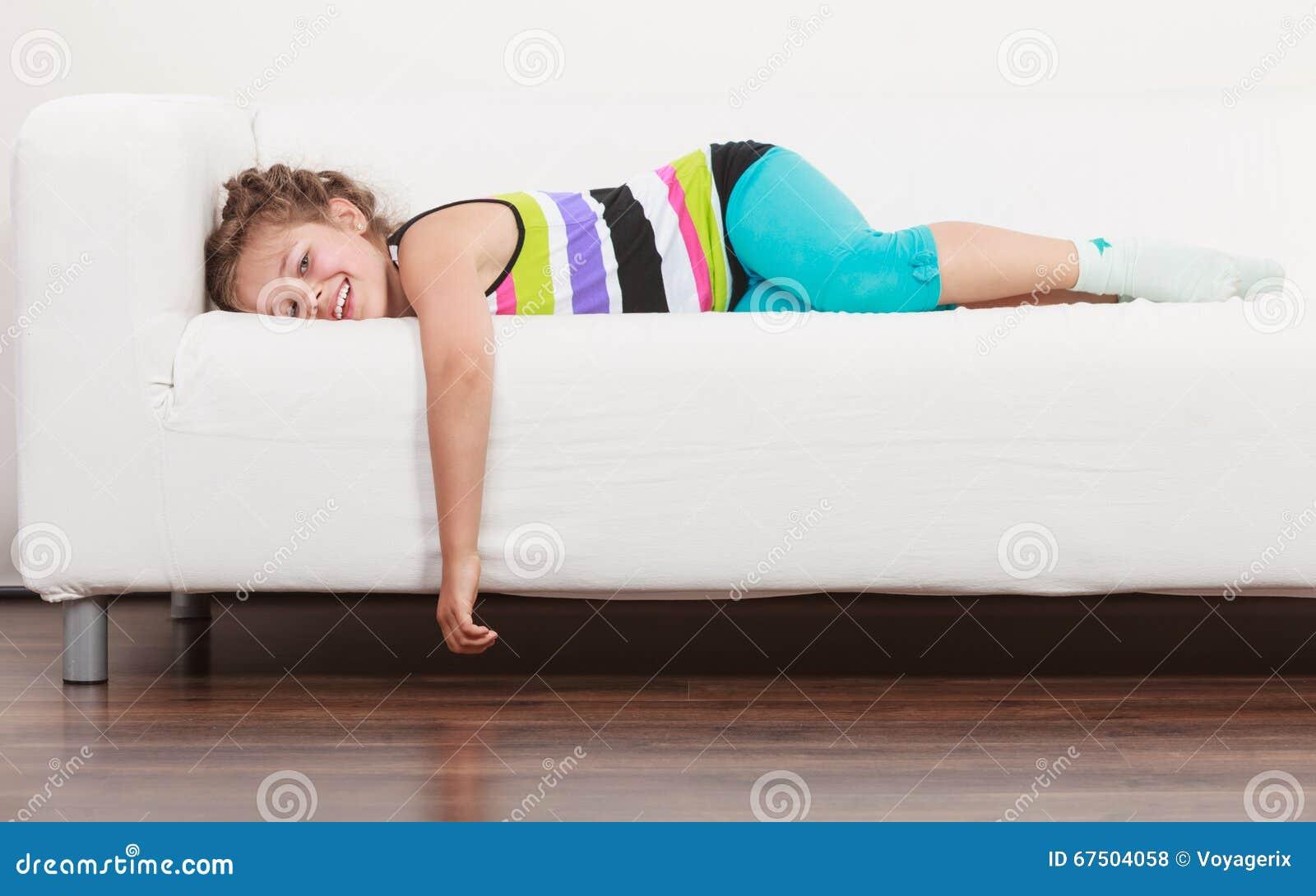 Happy Lazy Little Girl Kid Lying Sofa Stock Image