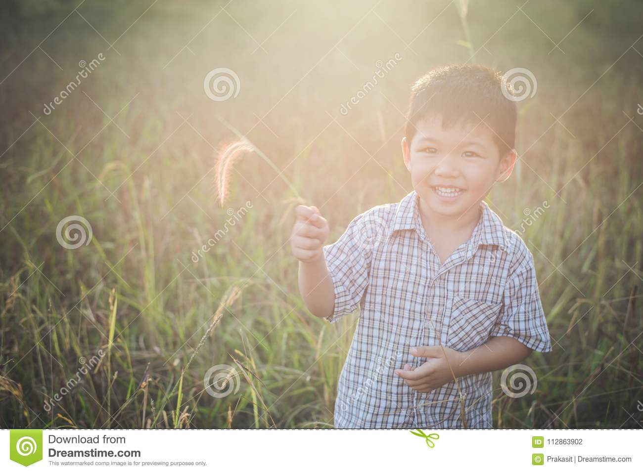 df978299d Happy Little Asian Boy Playing Outdoors. Enjoy Life. Cute Asian ...